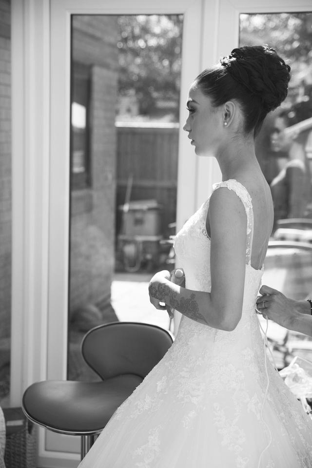bride looking in the mirror before her muslim wedding