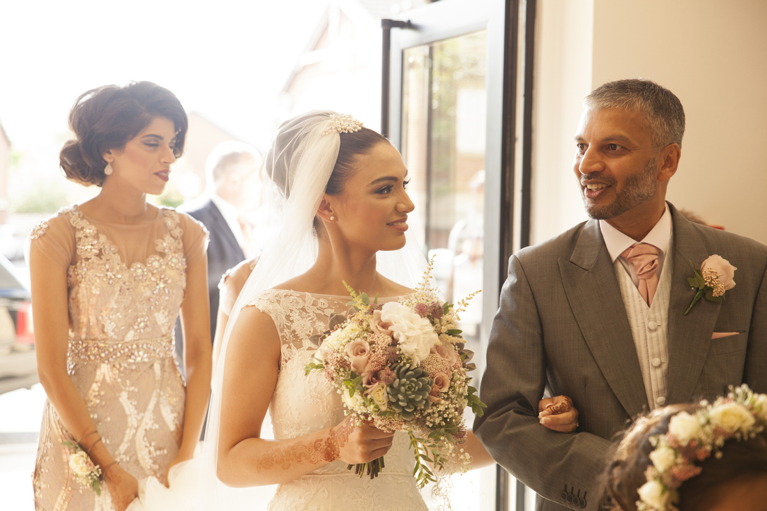 bride looking lovingly at the father of the bride before the muslim ceremony in preston lancashire
