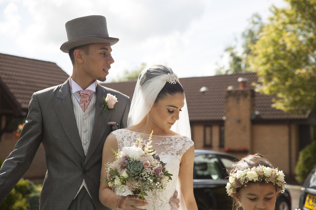 best man with the bride at a muslim wedding wearing veil and wedding dress