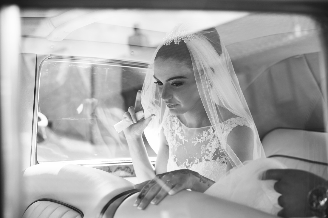 bride in the car after her muslim wedding in preston lancashire