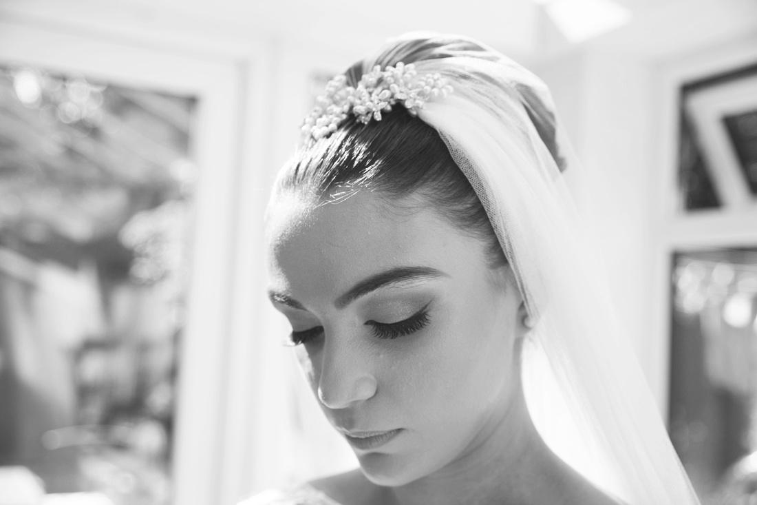 bride of a muslim wedding looking down wearing a veil